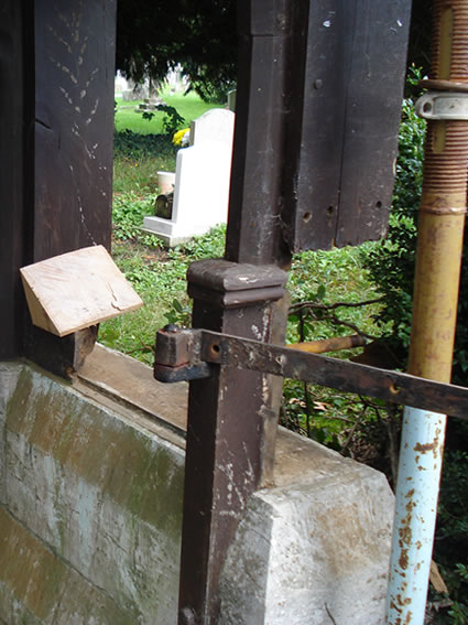 Before repairs to rotten Grade II listed lych gate