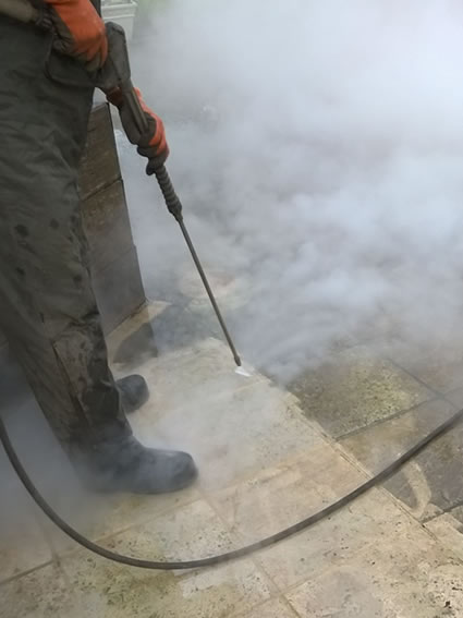 Stone paving being cleaned using the DOFF steam system